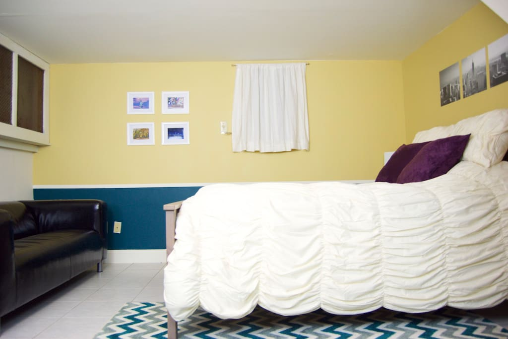 Guest Bedroom - Queen-size bed with a pillow top mattress, classic leather sofa, heating/AC, and lots of space.