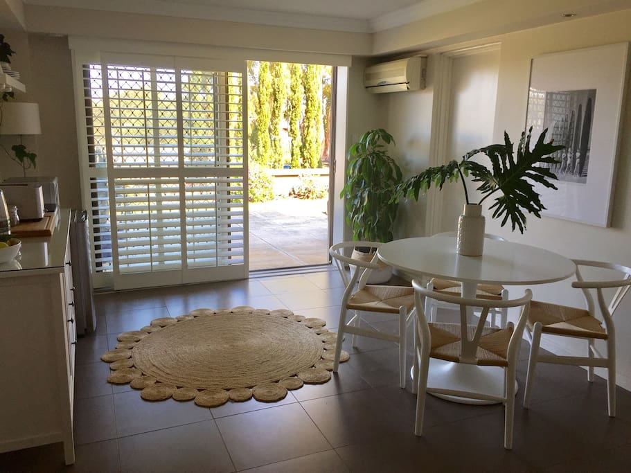 Dining area and access to outside private courtyard garden.