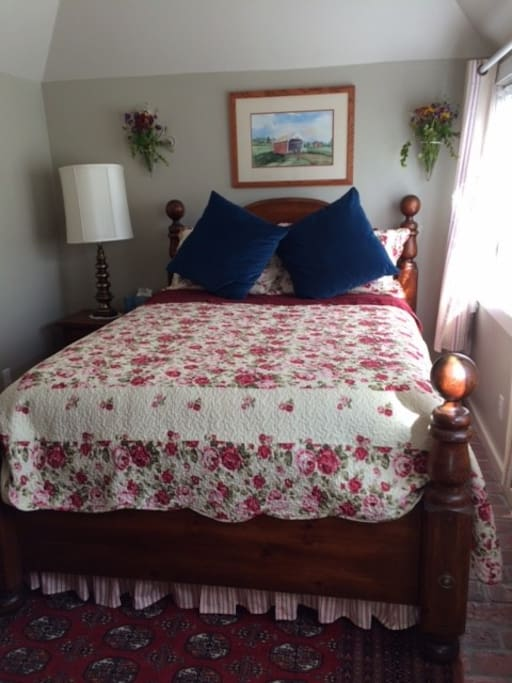 Separate bedroom with comfortable queen bed, lace curtains & drapes, TV, desk/vanity, wardrobe.