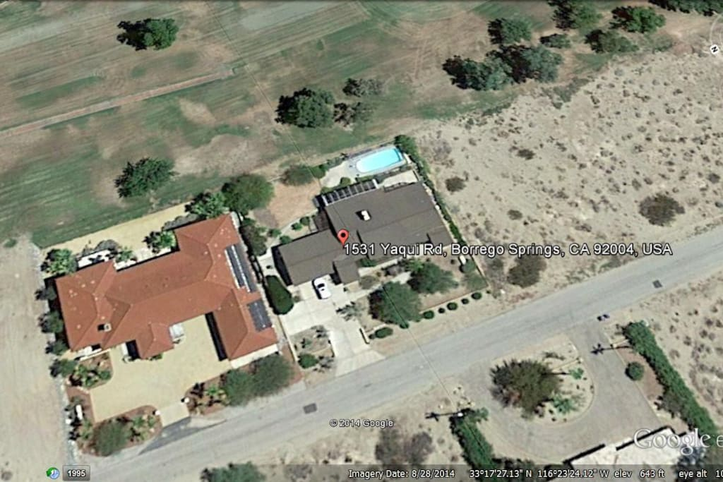 Aerial view of house.  It is the one on the right with the pool.