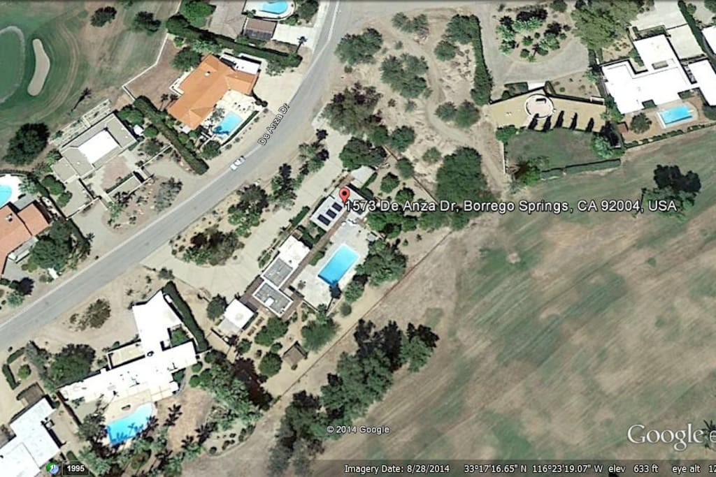 This shows our house with the pool we share with our neighbor