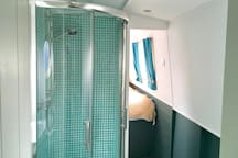 Separate bathroom with power shower, toilet and sink