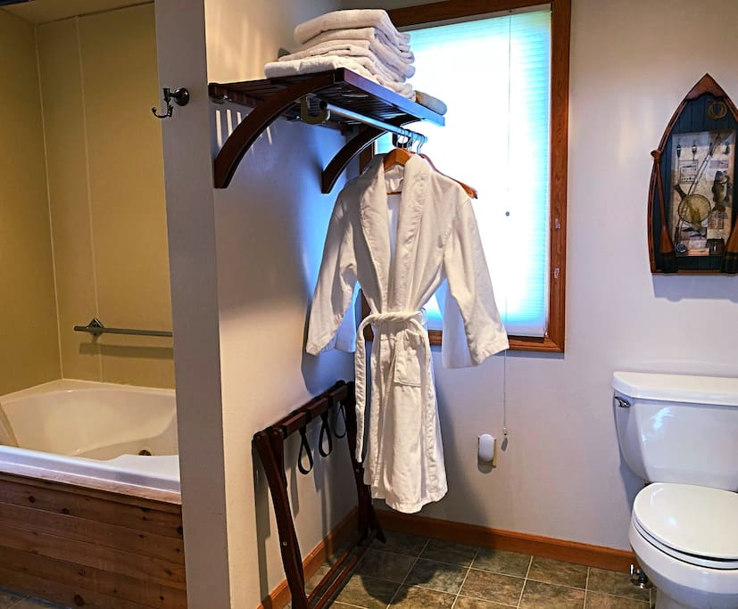 Large bathroom with robes