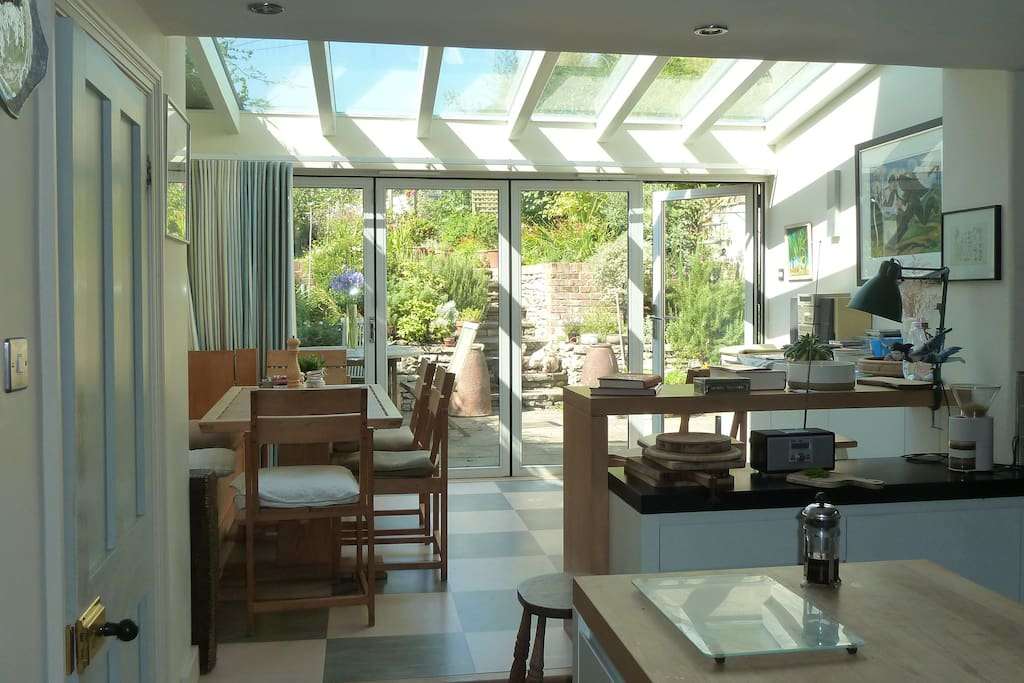 The dining area through the kitchen with beautiful handmade table and chairs. The folding sliding doors lead through to the garden where guests can sit up on the lawn and enjoy peace and privacy yet only five minutes away from the centre of the town.