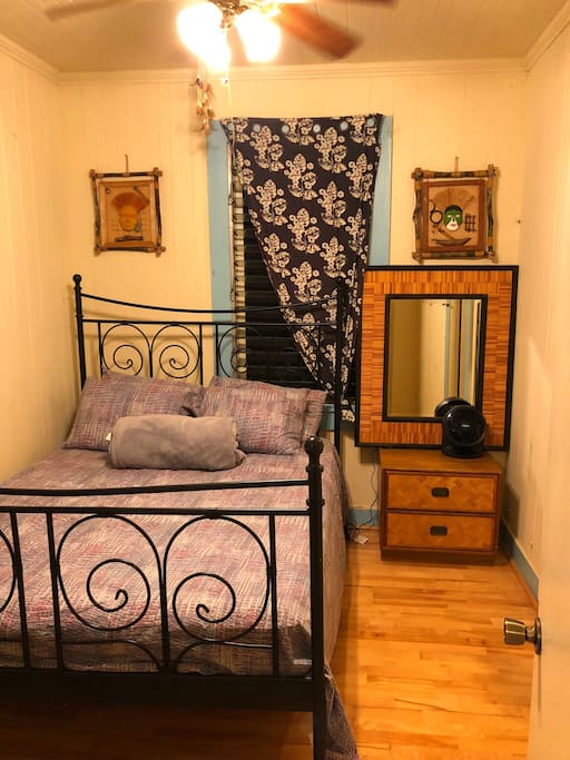 Bedroom #1: Queen size bed, ceiling fan, portable fan, mirror, small closet and drawer.