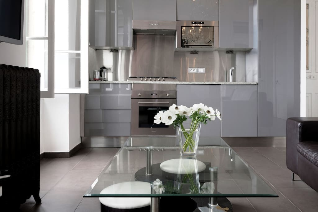 Kitchen Area: Glass cabinets with under counter halogen lighting; granite worktop; stainless steel splashback/ Smeg oven and gas hob/sink. Integrated fridge/freezer/washing machine/dryer/microwave.  Kettle, toaster and Coffee perculator