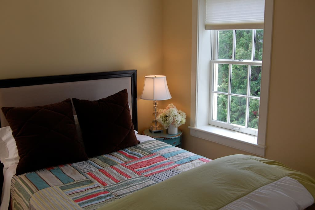Queen size with crisp linens and down comfort
