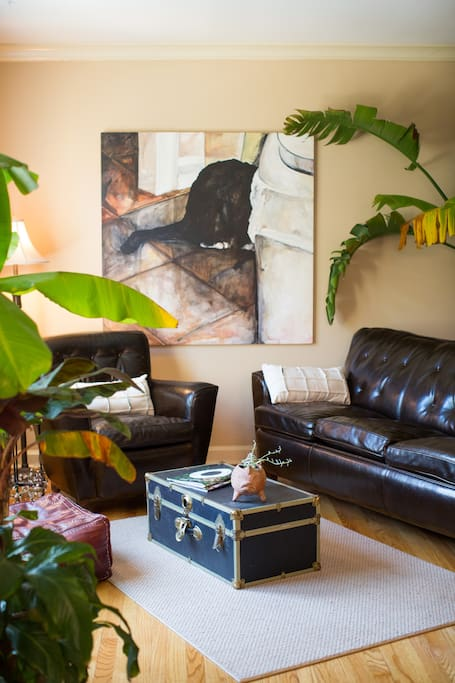 Relaxing living room featuring works of Omaha artists.