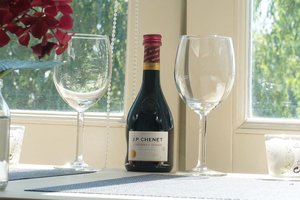 A little bottle of wine is waiting for you.