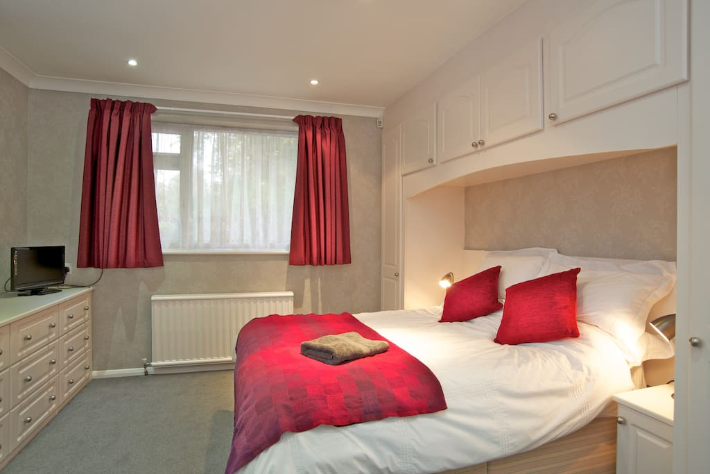 The main bedroom has plenty of drawer and wardrobe space and a TV for breakfast TV viewing.