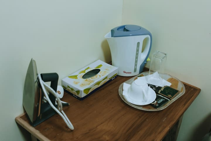 Electric kettle provided with cup, coffee & tea for you to prepare your own beverage. Iron box is also provided
