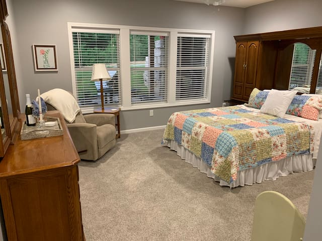 Select comfort bed with soft sheets and cozy quilt
