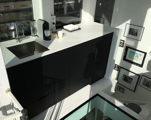 Kitchen space on the 5th floor (roof terrace) with a Nespresso machine, and refridgerator.