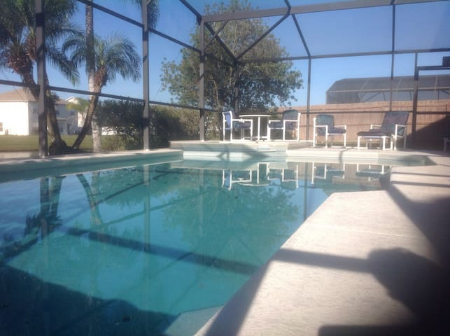 Large private south facing pool, spa and sun deck overlooking gardens and lake