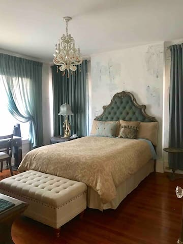 We just upgraded the Peacock room with this elegant headboard. You will feel like royalty sleeping here!