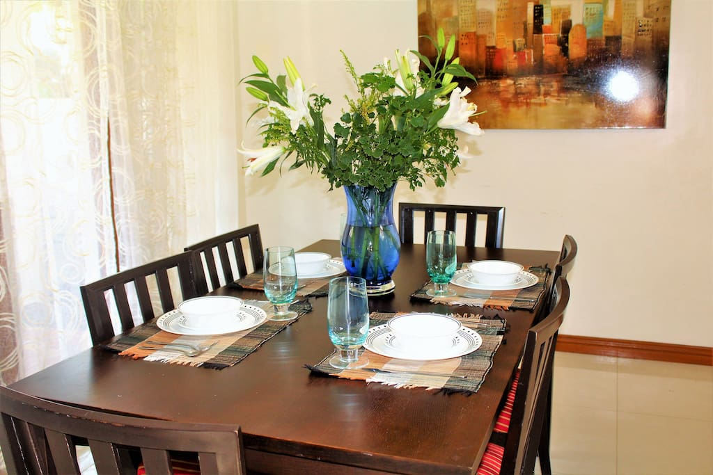 Seating for 6 with imported dining wares and wine glass..