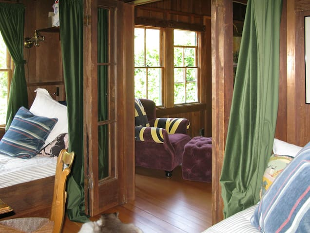 Second bedroom/ sleeping porch with daybeds and desk.