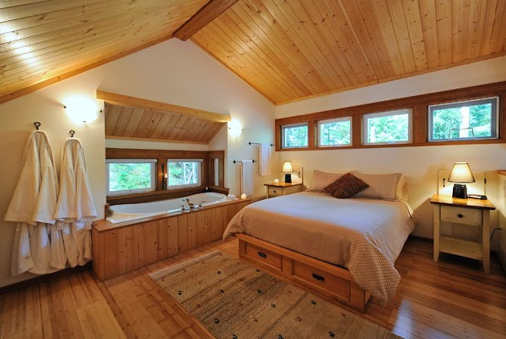Soaker Tub for Two by the luxurious Queen Bed.