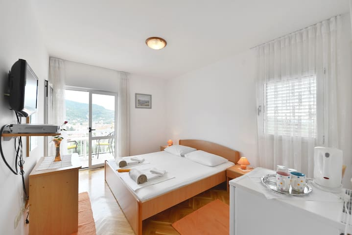 Nice room near center with sea view