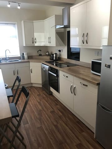 Well equipped kitchen with dishwasher, microwave, kettle, toaster, full oven and hob, fridge/freezer and washing machine