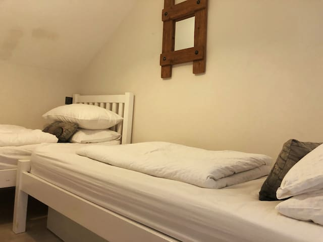 and twin bed sleeping, on a mezzanine
