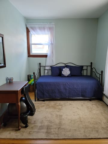 Daybed/trundle bedroom (first floor). Two twin mattresses (one day bed, one trundle).