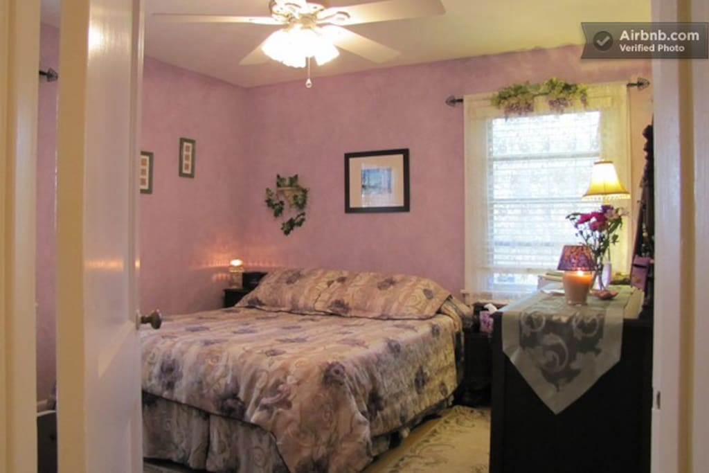 Comfortable queen bed, dresser, closet and small fridge