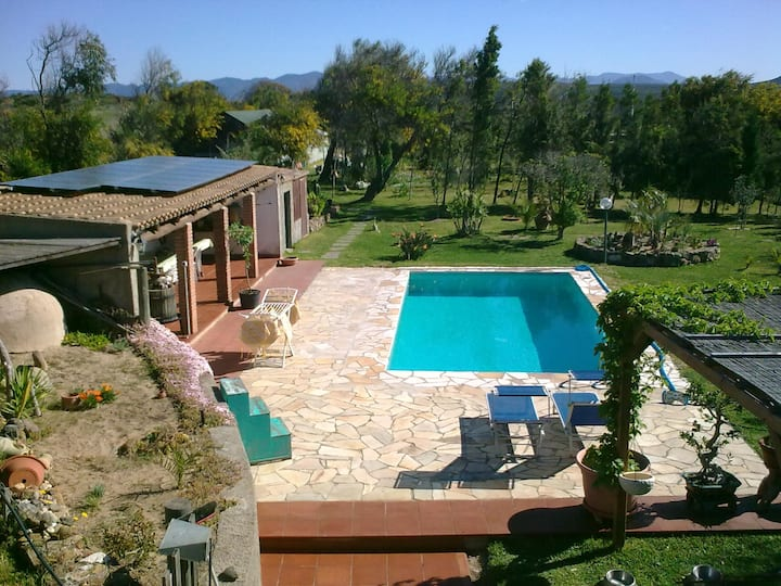 Large double room in villa with pool.