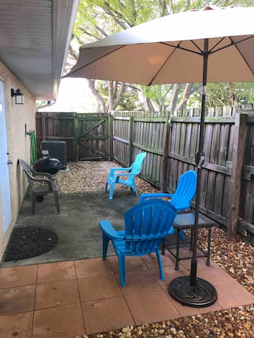 Fenced in yard with barbecue grill