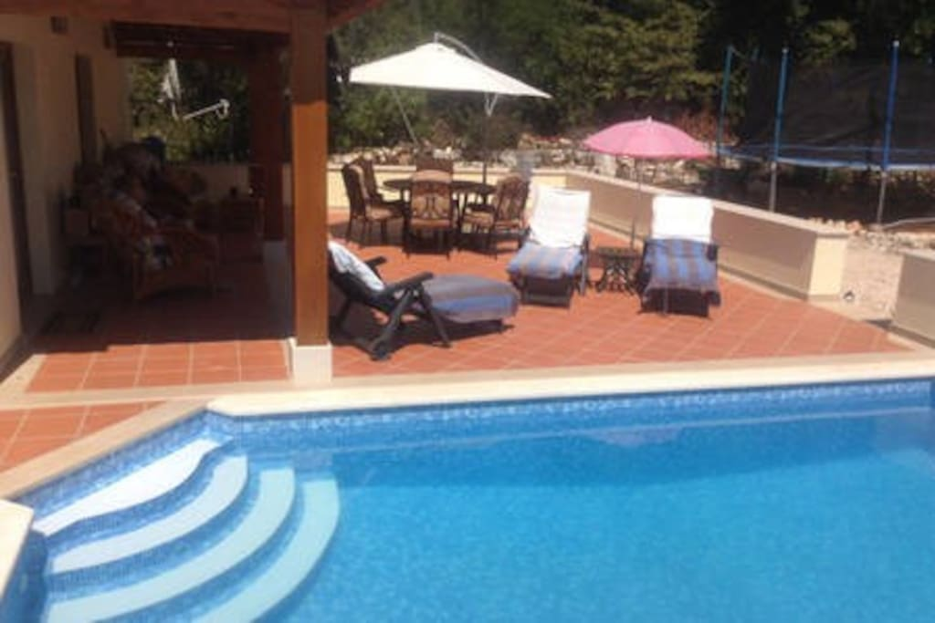 Relax by the pool with sun and shade