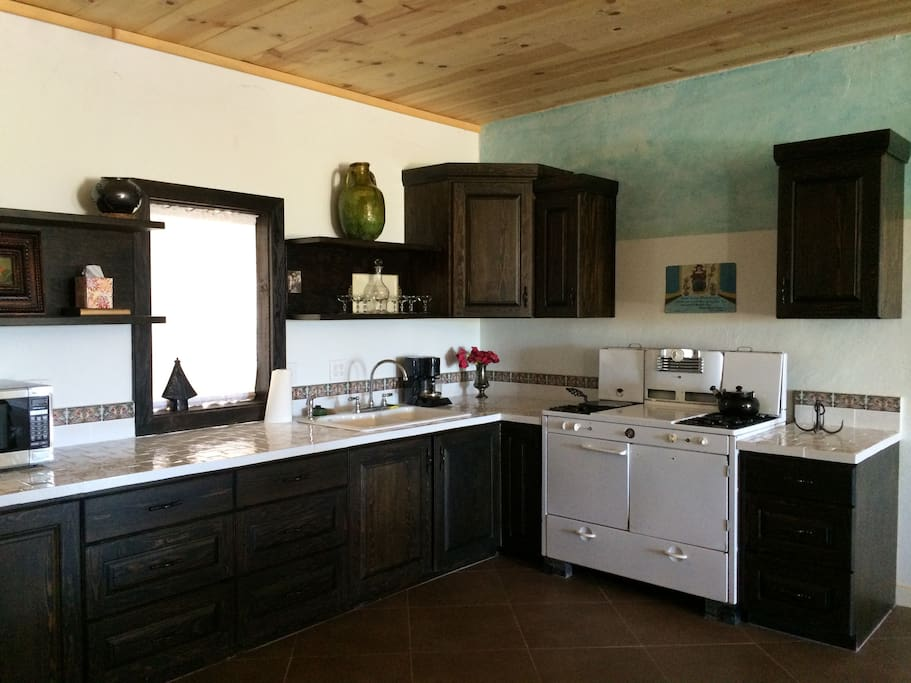 Spacious Mexican-style Kitchen, all amenities, flatware, dishes, pots pans, etc