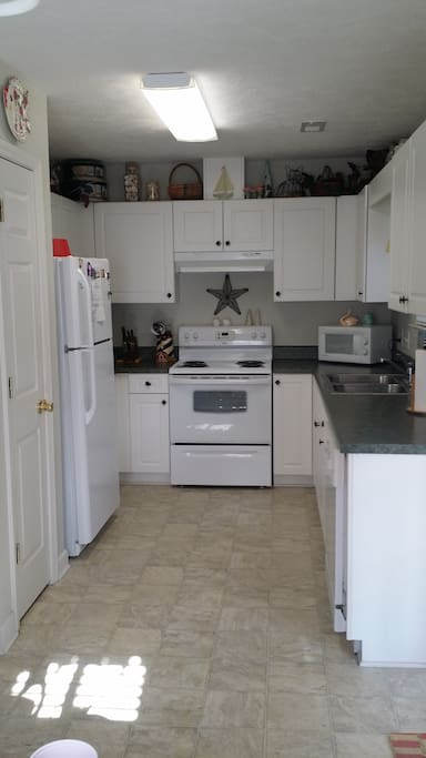 The Full Kitchen Has All You Need To Create A Delicious Meal!! If You Prefer An Adult Beverage There Is A Blender Available Or Wine Glasses For Our Wine Lovers Out There. There Is A Pantry For All Of Your Groceries As Well As Lots Of Cabinet Space.
