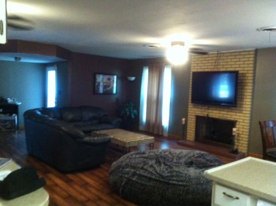 Living room with large TV & fireplace