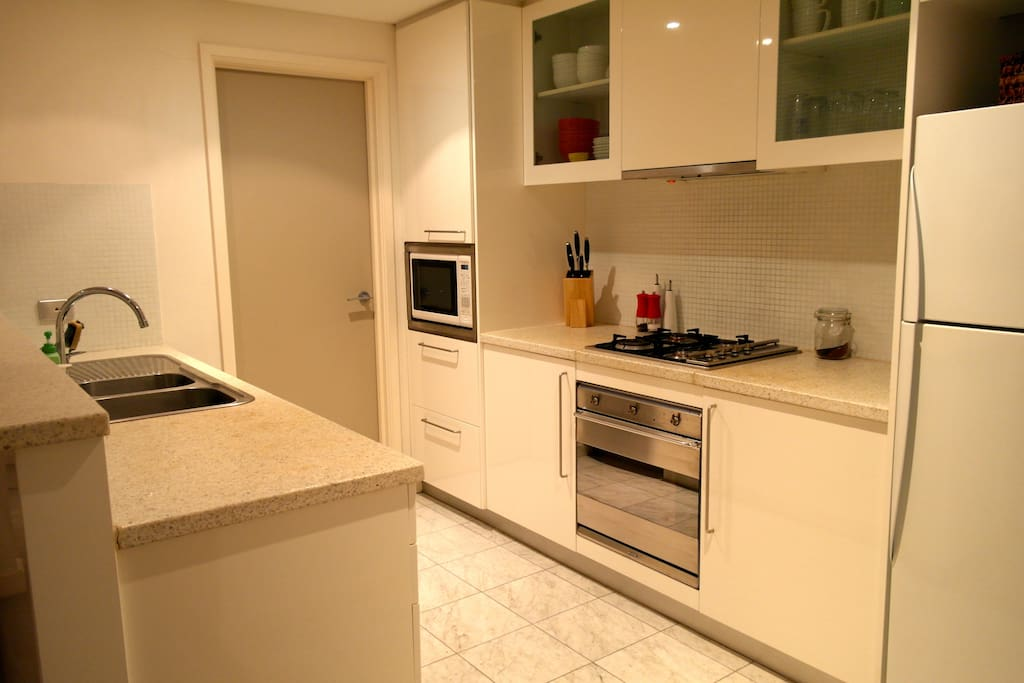 Fully equipped kitchen with modern appliances.