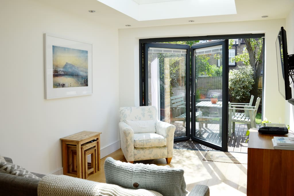 Bright living area with skylight and sliding doors onto garden