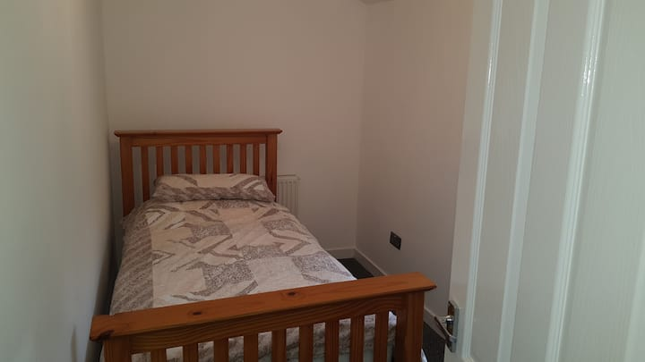 Single room in clean pet free home.