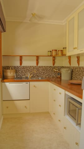 Self-contained kitchen with dishwasher. Three-way Microwave with an air fryer, BBQ  on the veranda.