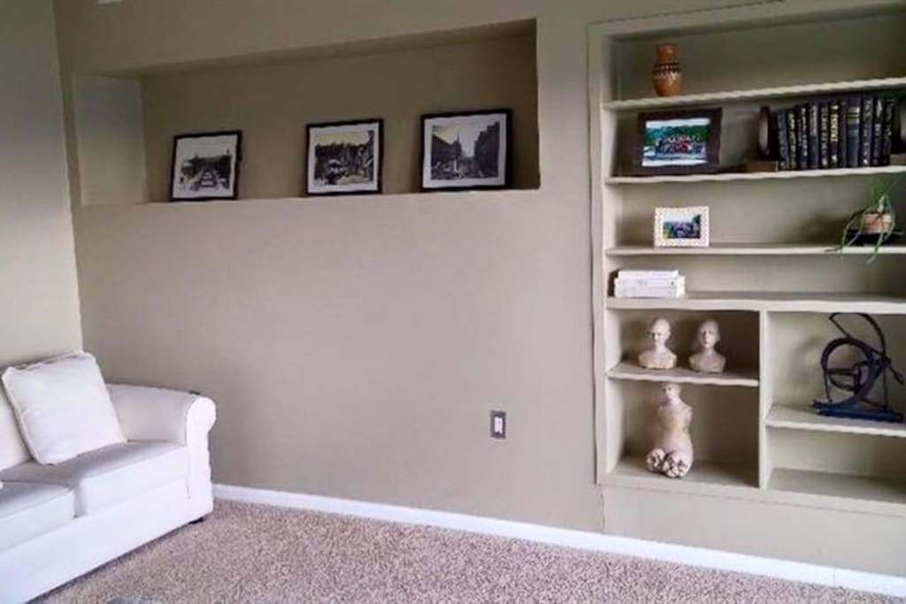 Guest bedroom shelves (couch not included)