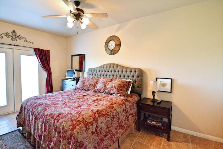 King Bedroom, flat screen TV, private access to patio, private bathroom