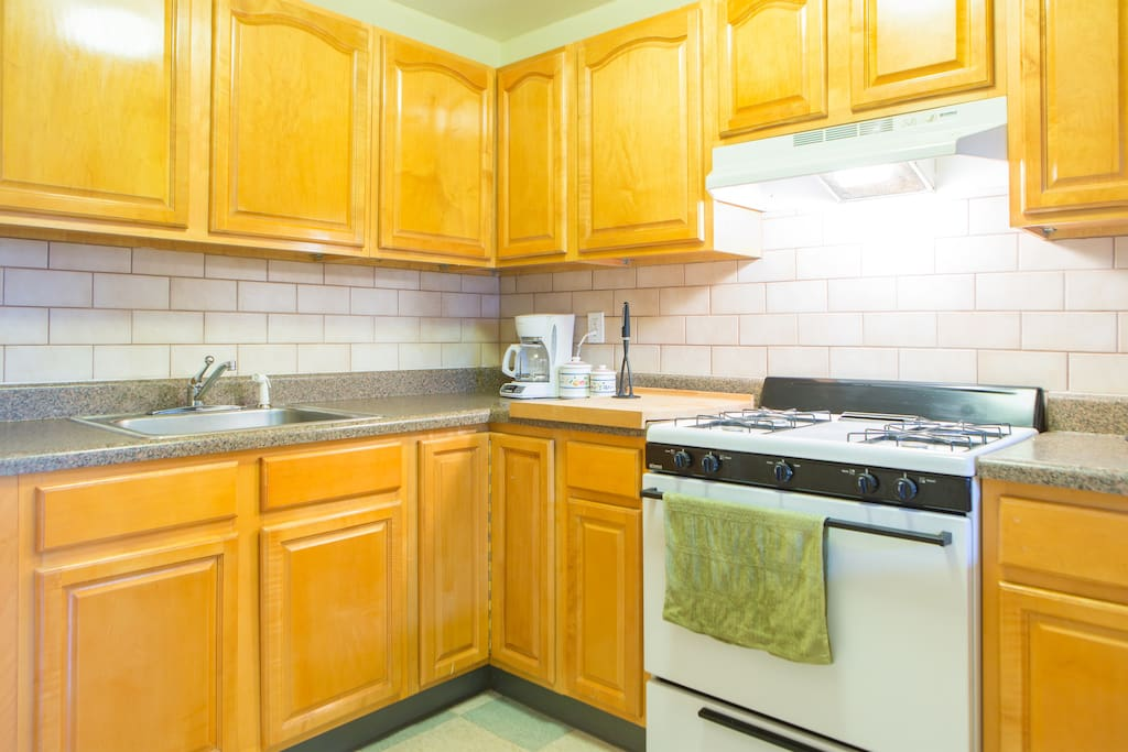 Full kitchen has dishes, glasses, silverware,  pots, pans, toaster, coffee-maker, blender and spices.  Help yourself.
