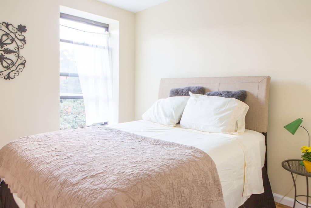 Quiet, clean bedroom sleeps 2 on a super comfy queen-size Serta Cool Sense mattress.