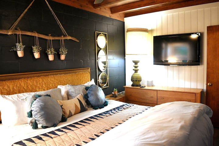 Master bedroom features a king size bed. Open the windows to hear the lake as you sleep. Better than any sound machine!
