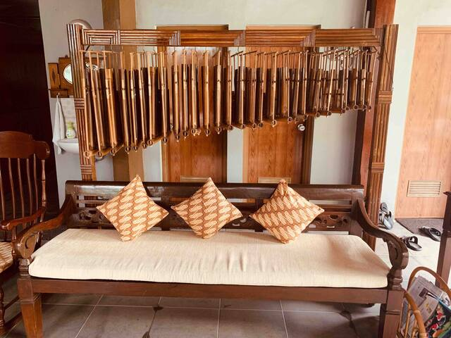 Main living room is furnished with a full-sized, antique angklung. Try out your musical talent on this well-tuned, traditional instrument!