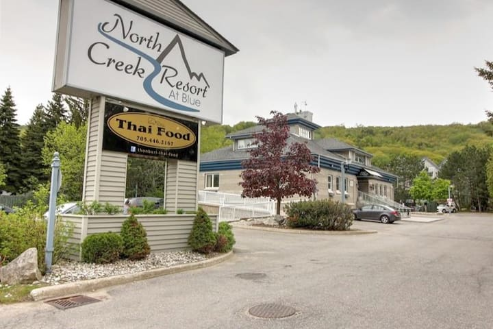 We are in North Creek resort,  conveniently  located beside Toronto ski club at the north end of Blue Mountain ski resort.  Fantastic Thai restaurant onsite or take the free shuttle to the village. North winds beach is just down the road as well.