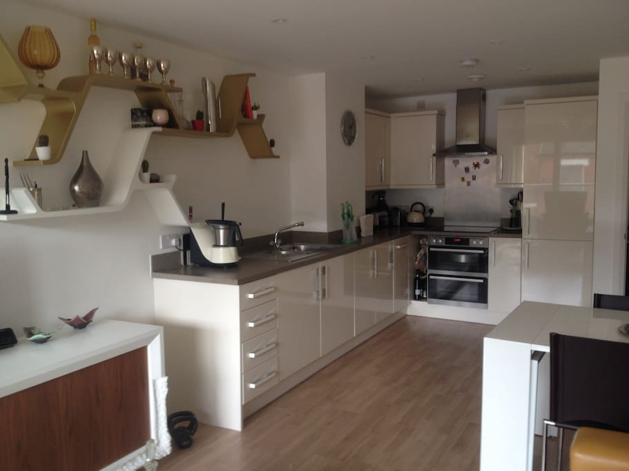 open plan kitchen with soft close cupboards dining table sits 6
