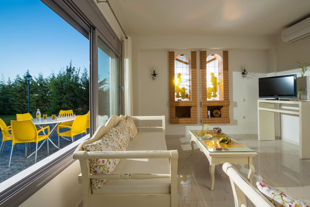 Sitting Room with View to the Pool Area and Garden