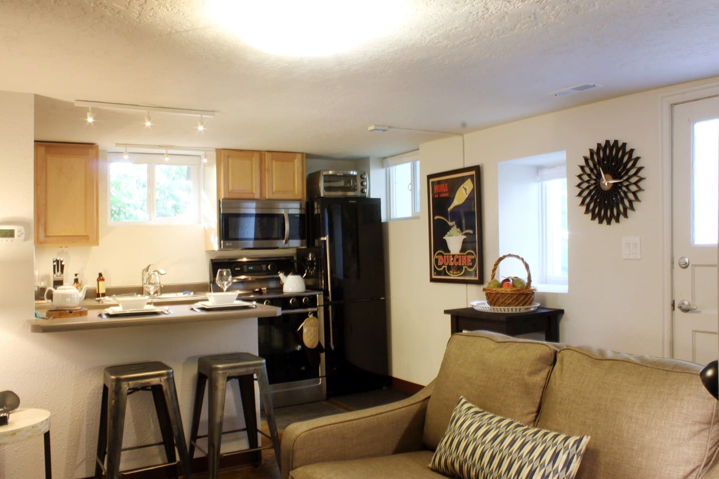 Kitchen has breakfast bar counter seating, Bosch stove, new microwave, and Bloomberg refrigerator (freezer on bottom).