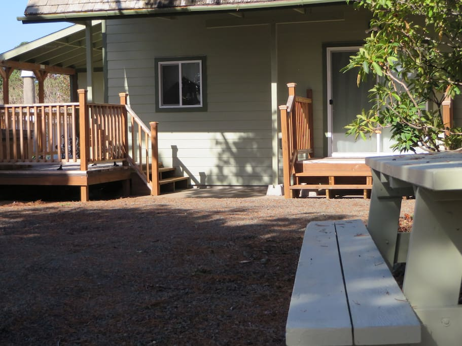Outdoor table to watch kids play in the yard. Deck is partially covered for outside use year round.