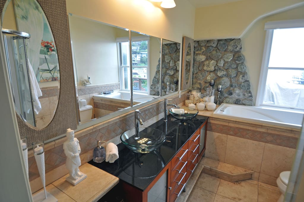 Bathroom with Jacuzzi Tub with a water view, Shower, Double Sinks and lots of cabinet space.