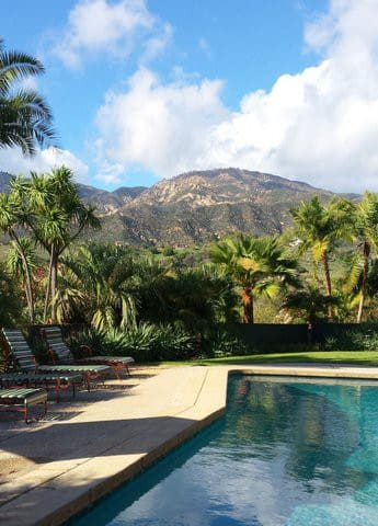 Mountain view, tropical landscaping from pool